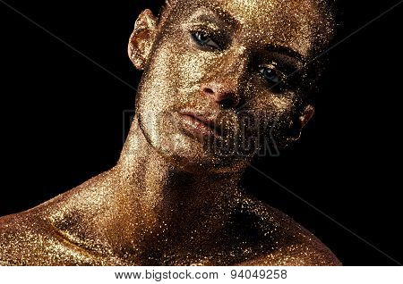 Gold makeup. Creative close-up portrait.