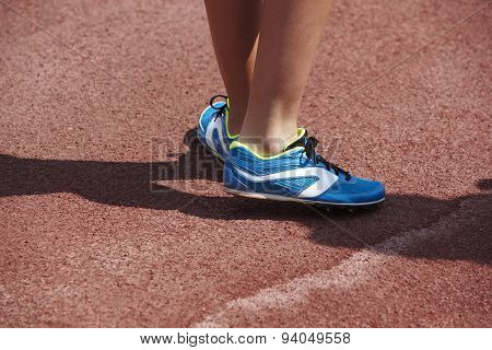 Jumping Sport Shoes In The Athletic Field Ground