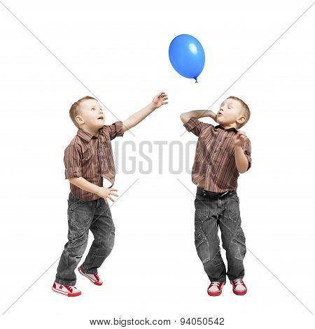Boy jumping with blue balloon