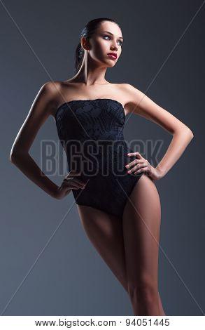 Studio Fashion Shot: Seductive Young Woman Wearing Black Swimsuit