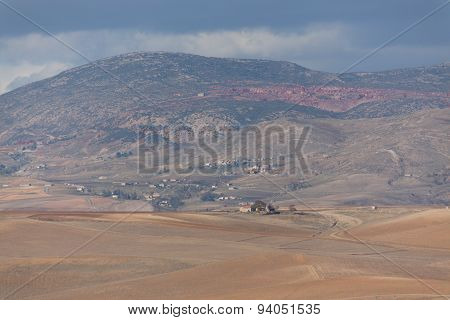 rural landscape with clouds, mountains, trees in the region of Setif