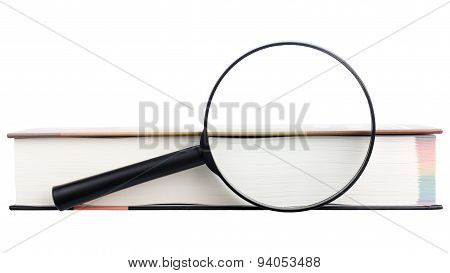 Magnifying glass and book