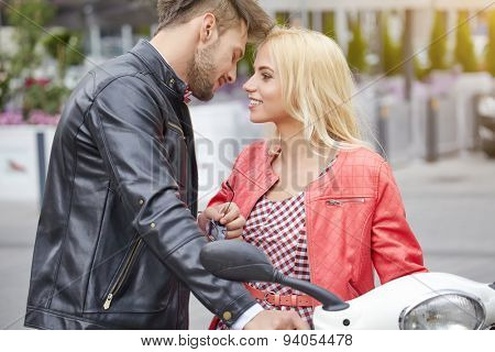 Young couple kissing each other on the street