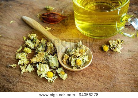 Chinese Chrysanthemum Tea On Old Wooden