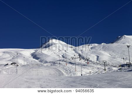 Winter Mountains And Ski Slope At Sun Day