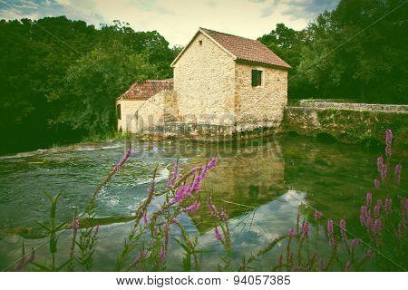 House on  Krka river in Krka national park in Croatia