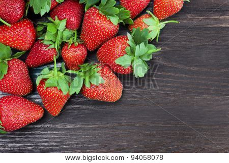 Strawberries on a wood background