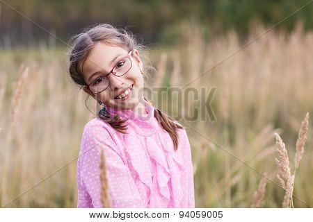 Adorable girl in glasses