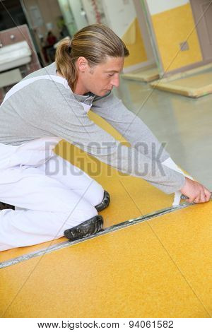 Craftsman installing plastic flooring