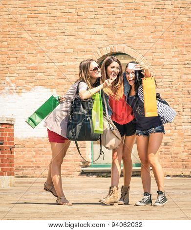 Group Of Happy Girlfriends Best Friends With Shopping Bags Taking A Selfie In The City Center