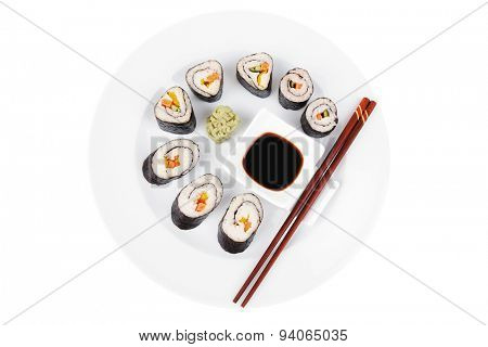 Japanese Traditional Cuisine - California Roll with Salmon (sake), Cream Cheese and Tuna (maguro) . on white dish with sticks isolated over white background