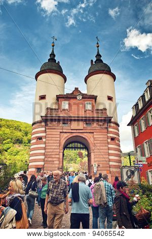 HEIDELBERG, GERMANY - APRIL 26: Tourists Crowded Around Old Bridge Gate, a Popular Tourist Attraction in Heidelberg, Baden-Wurttemberg, Germany on April 26, 2015