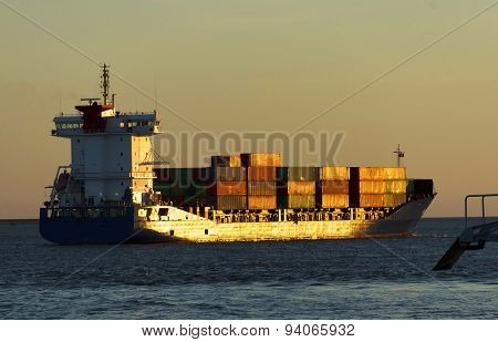 Huge container cargo ship in sunset light