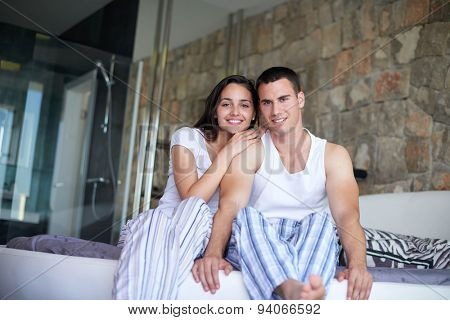 happy young couple relax and have fun in bed