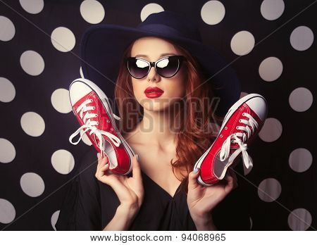 Portrait Of A Redhead Girl With Gumshoes