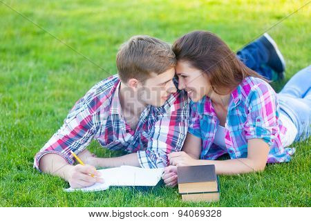 Young Teen Couple With Notebook