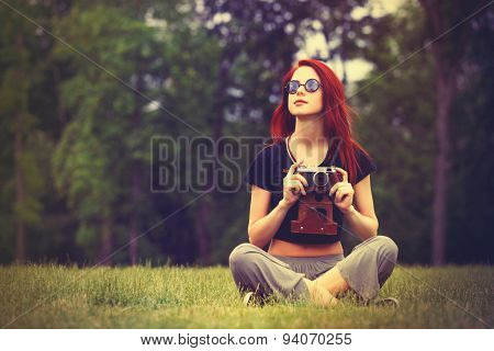 Young Girl In Indie Style Clothes With Retro Camera