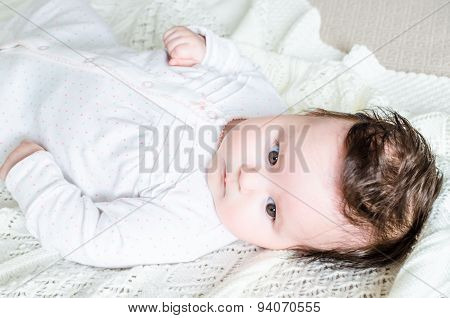 Portrait Of Cute Sweet Little Newborn Baby Girl