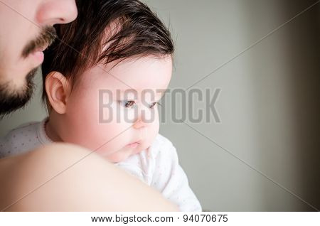 Portrait Of Happy Beautiful Little Baby Girl Sitting Oh Father's Hands