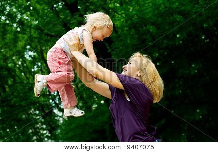 mother with young daughter in the park