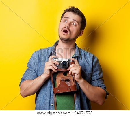 Guy In Shirt With Vintage Camera
