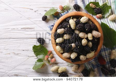 White And Black Mulberries In A Wooden Bowl Horizontal Top View