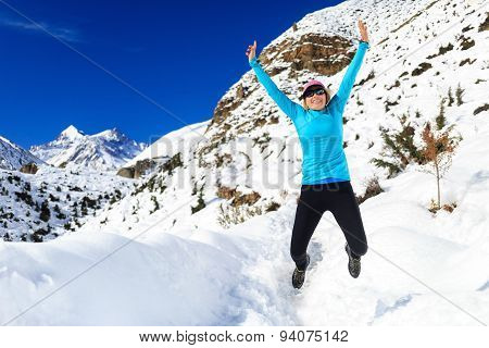 Woman Jumping And Running In Winter Mountains