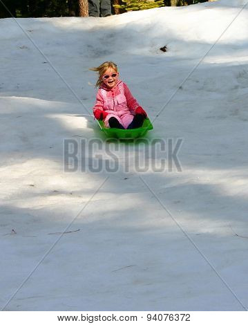 Smiling Girl On Sled