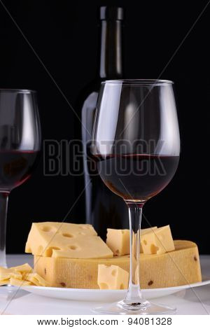 Red Wine In Glasses And Cheese