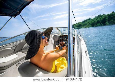 Woman driving yacht