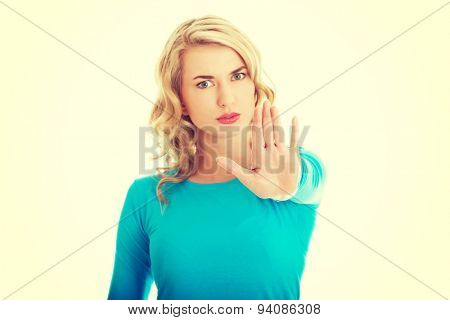 Woman expressing NO gesture with hand