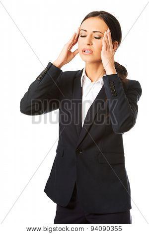 Tired businesswoman having huge headache.