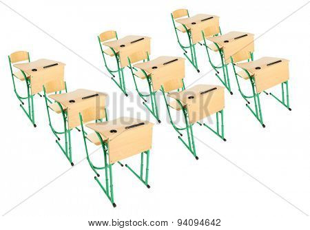 School wooden desks and chairs isolated on white