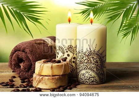 Beautiful spa composition with decorative Indian candles on nature background