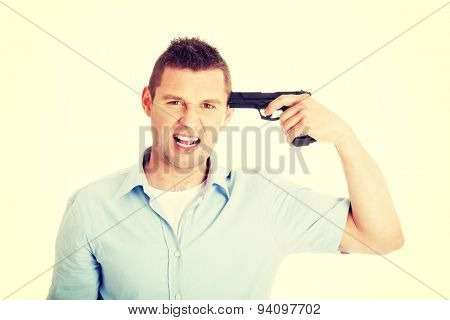 Man with gun trying to make suicide.
