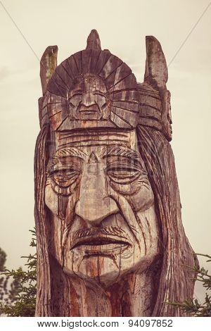 statue of an indian head totem