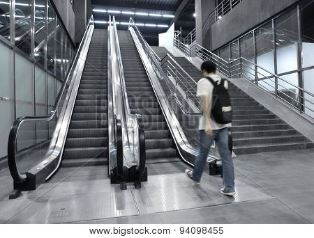 People rushing on escalator