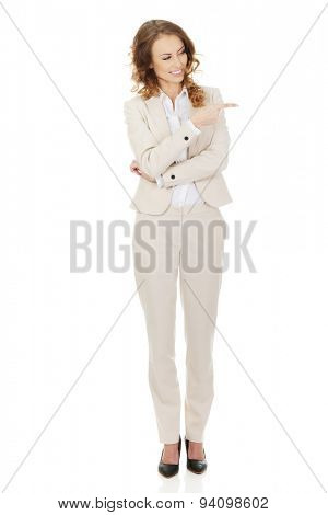 Businesswoman pointing aside on space.