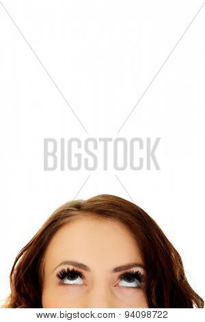 Beautiful woman's eyes looking up.