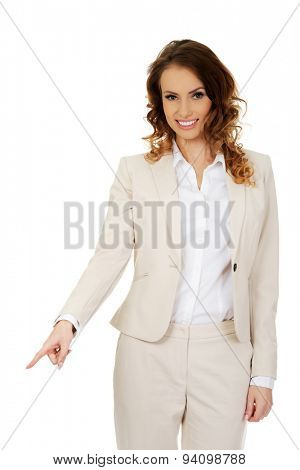 Businesswoman pointing down on space.