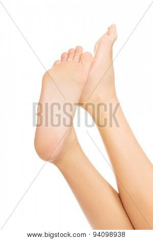 Woman's smooth caucasian bare feet.