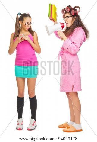 Funny housewife with books and megaphone screams to girl isolated