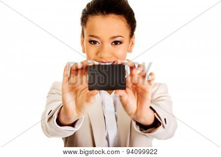 African businesswoman holding a card.