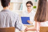 stock photo of psychologist  - Psychologist helping to young couple in her private consulting room - JPG