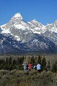 Teton Mountain Range And Tourists poster