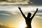 picture of open arms  - strong confidence woman open arms under the sunrise at seaside - JPG