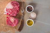 picture of veal  - Raw fresh cross cut veal shank and seasonings for making Osso Buco on wooden background - JPG