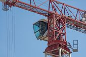 foto of cabs  - Drivers cab of a crane high in the blue sky copy space - JPG