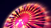 picture of ferris-wheel  - Abstract ferris wheel with motion blur and lights at night - JPG