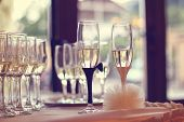 picture of wedding feast  - Glasses filled with campagne on wedding day - JPG
